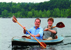 Peter Espenshade and Chris Boget paddling a kayak on Lake Champlain