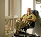 Larry Hall sitting in an office chair