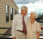 Elizabeth and Lester Wallman looking at eachother in front of Lake Champlain